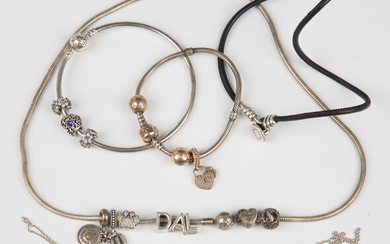A collection of Pandora silver jewellery, comprising a necklace with sliding charms, a bracelet, a b