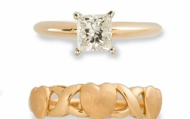 A diamond and fourteen karat gold ring and gold band