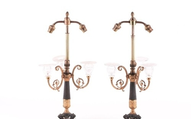 A pair of French Empire style lamp bases, with a reeded bras...