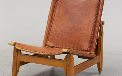 A walnut and leather lounge chair, Artesano, mid 20th Century.