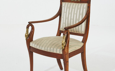 ARMCHAIR, first half of the 19th century, empire, solid mahogany, decoration in gilded bronze, armrests in the form of goosenecks, foot ends in the form of lion paws.