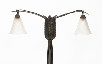 An Art Deco wrought iron two-light lamp in the manner of Edgar Brandt