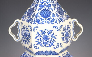 CHINESE BLUE AND WHITE PORCELAIN HEXAGONALLY-PANELLED DOUBLE GOURD-FORM, TWO-HANDLE VASE....