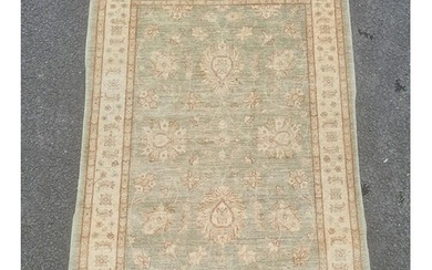 Pale green ground modern Eastern-style rug with foliate deco...