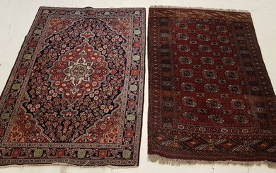 TWO HAND-KNOTED RUGS, one decorated with stylized flowers (Length 154...