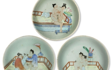 Three Chinese porcelain celadon-ground famille rose 'erotic' dishes, late 19th century, each painted with an amorous couple, 17cm-18.5cm diameter (4)