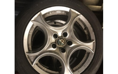 set of 4 alfa romeo alloy wheels- complete with center hubs