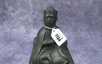 A Chinese XIX Century Bronze Model of a Seated Scholar, lean...