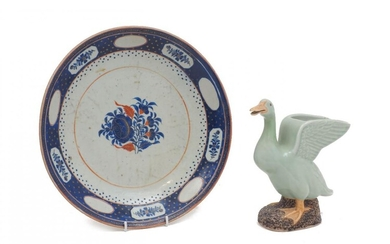 A Chinese export porcelain dish, 19th century, with central blue chrysanthemum design, 31.5cm diameter; together with a Chinese celadon glaze duck vase, 20th century, 22cm high (2)