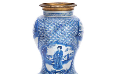 A GILT METAL-MOUNTED BLUE AND WHITE BALUSTER VASE