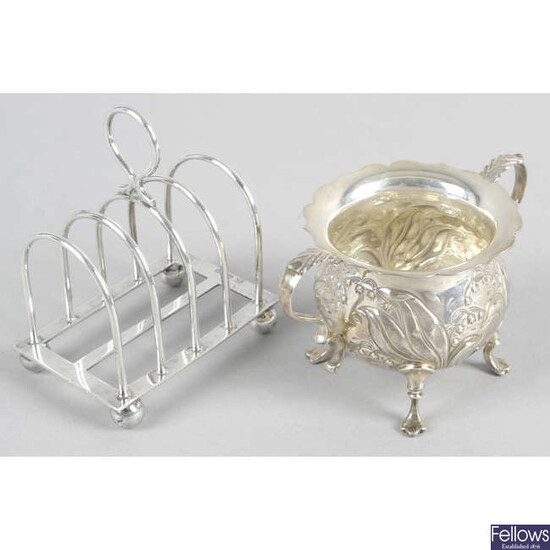 A George V small silver toast rack, together with a modern twin-handled sugar bowl. (2).