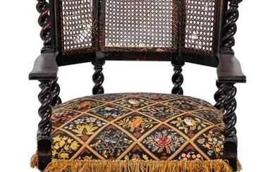 A Jacobean Style Carved Oak Cane Back Armchair Height