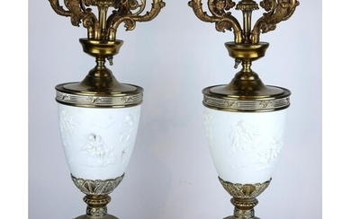 A PAIR OF LARGE CONTINENTAL BRASS AND BISQUE FOUR BRANCH TAB...