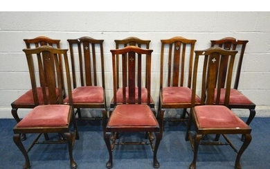 A SET OF EIGHT EARLY 20TH CENTURY STAINED BEECH DINING CHAIR...