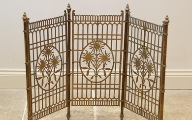 A brass floral three panel fire screen, 20th century, each p...