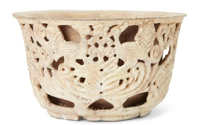 A carved pottery bowl, Southeast Asia,19th century or earlier, of deep form with double skin, the outer openwork shell carved with birds and vegetal designs, the inner skin solid, 29cm. diam. x 16cm. high Provenance: Private Collection Oliver Hoare...