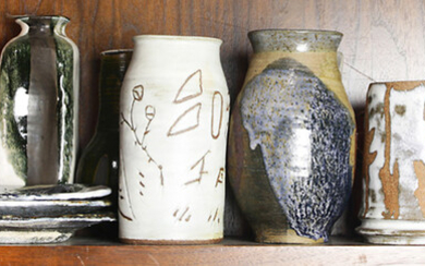 A collection of art pottery vases and decorative items
