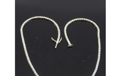 A diamond line necklace set in 18ct gold, total estimated we...