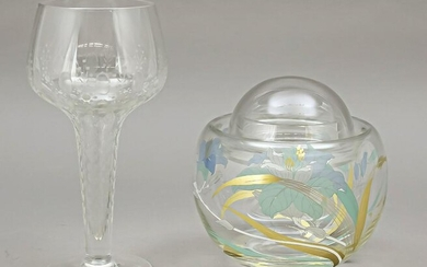 A footed glass and a lidded ja