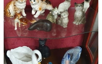A good quantity of Beswick, Royal Doulton and other Animals.
