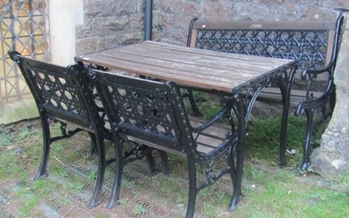 A heavy cast iron framed four piece garden suite comprising ...