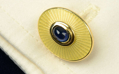 A pair of 18ct gold sapphire cabochon and yellow guilloché enamel cufflinks, with hinged reverse, by Deakin & Francis.