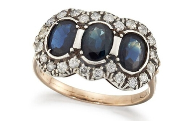 A sapphire and diamond ring, of triple cluster design, composed of three collet-set oval mixed-cut sapphires with brilliant-cut diamond border, to a plain hoop, ring size P
