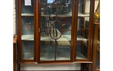 An Edwardian mahogany and inlaid display cabinet, with centr...