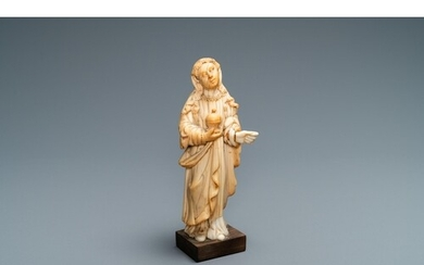 An Indo-Portuguese ivory figure of Mary Magdalen with an oin...