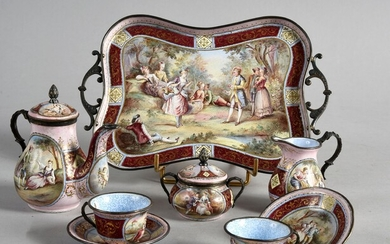 MINIATURE TEA SERVICE, VIENNA, CIRCLE 1900.Head to head model, in polychrome enamels with romantic scenes, gilt mount, consisting of a tray (good condition), a teapot (accident), a covered sugar bowl (good condition), a milk jug (good condition)...