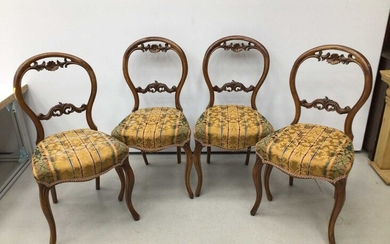 Set of four Victorian walnut balloon back chairs