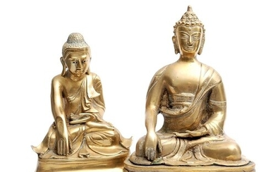 Two Chinese polished cast metal Buddha figures, each modelle...