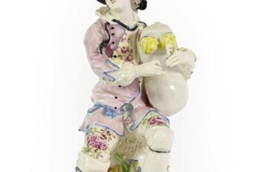 A Bow Porcelain Figure of a Bagpiper, circa 1765, seated...