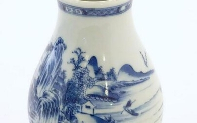 A Chinese blue and white vase decorated with a