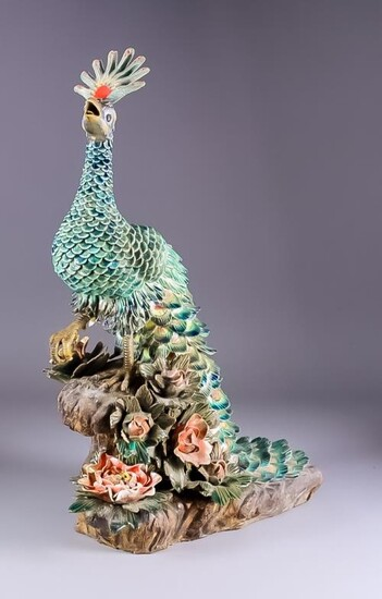 A Continental Glazed Terracotta Model of a Standing Peacock,...