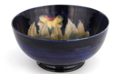 A MOORCROFT BURSLEM FOOTED BOWL decorated in the B