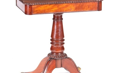 A WILLIAM IV FLAME MAHOGANY LAMP TABLE with gadrooned moulde...