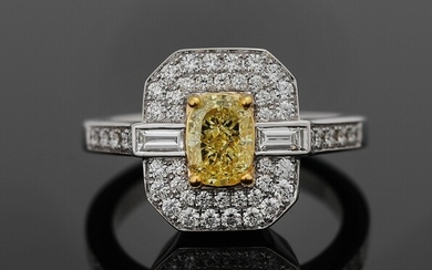 NOT SOLD. A diamond ring set with a Fancy Yellow diamond weighing app. 1.05 ct....