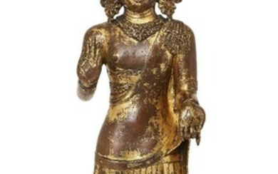 A large Sino-Tibetan gilt bronze standing figure of Avalokiteshvara, 17th century, the right hand is raised in abhayamudra and the left in varadamudra, wearing an elaborate crown and floral earrings, the neck adorned with an engraved necklace...