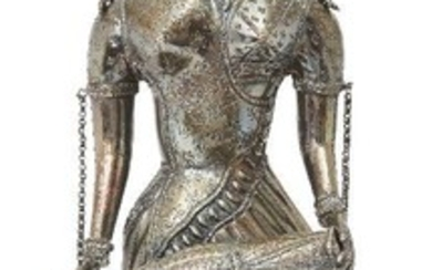 A large silvered metal figure of a female drummer, India, 20th century, on a high domed base, her robes with pattered detail and chain attachments to arms, ear and forehead, 47.3cm. high