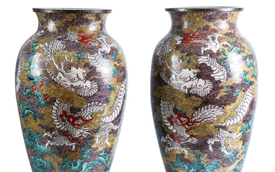 A pair of Chinese porcelain vases with dragons motifs,...