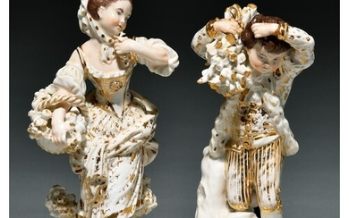 A pair of Derby figures of a boy and girl as Winter and Autu...