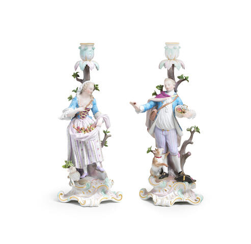 A pair of Meissen figural candlesticks together with a Meissen candlestick allegorical of Winter, late 19th century