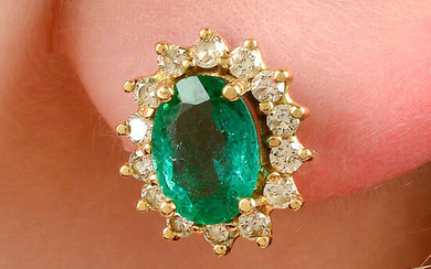 A pair of Zambian emerald and brilliant-cut diamond cluster earrings.