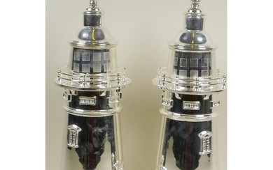 A pair of silver plated cocktail shakers in the form of ligh...