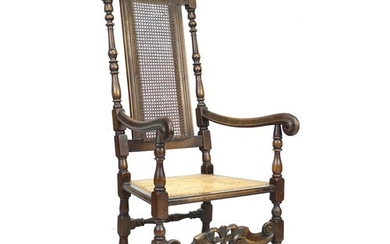 A walnut 17th century style armchair, with carved decoration...