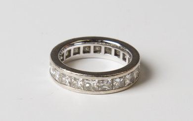A white gold and diamond full eternity ring, mounted with princess cut diamonds, weight 6.3g, ring s