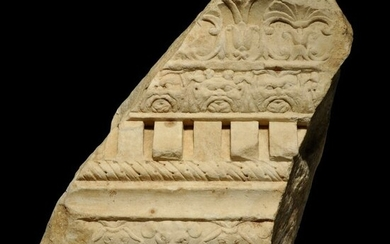 Ancient Roman Marble Architectural fragment of a Cornice with floral and faces of god Bes + mouses deco. H: 31 cm. Nice.