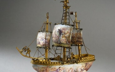 * MINIATURE GALION WITH THREE MASTS, VIENNA, circa 1900.In polychrome enamels decorated with romantic scenes, resting on a gilt bronze base decorated with a Poseidon, ending on an enamelled base of oval and curved shape.Austrian work, Vienna, circa...