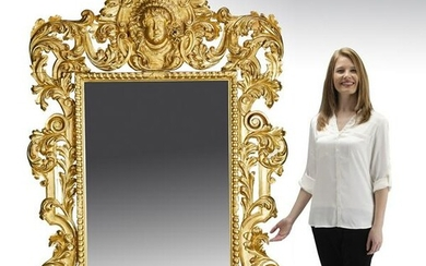 Monumental giltwood mirror in the Baroque style